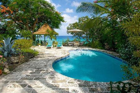 Secluded Senderlea sits cliffside with stairway beach access & tropical pool - Image 1 - Derricks - rentals