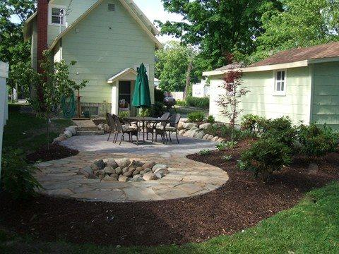 Imagine relaxing on the patio with a stone firepit for evenings - 110 Monroe - One block to Kids Corner and the beach - Weekly stays begin on Friday. - South Haven - rentals