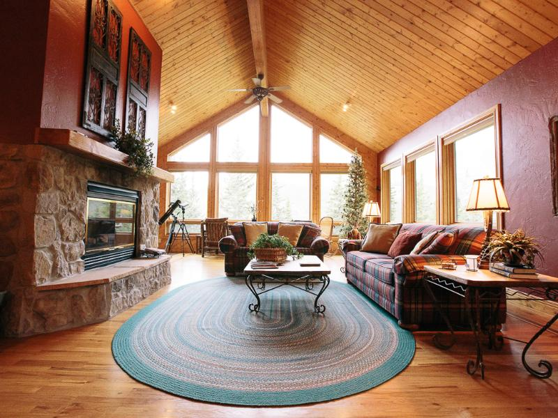 Main living area is very open with a wall of windows facing the mountain - It's time to book your summer vacation! - Breckenridge - rentals