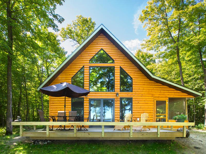 Wall of windows, deck, and screened porch - cabin overlooks lake. - Strawberry Lake Rental Cabin in N.W. Minnesota - Detroit Lakes - rentals