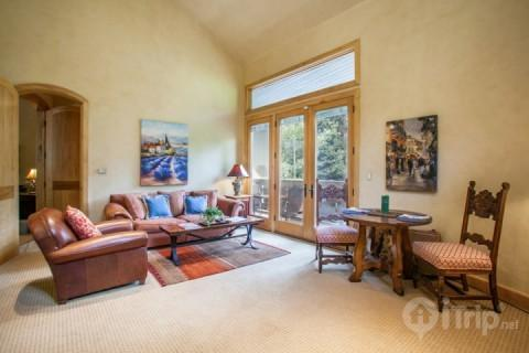 Beautiful European style living room, french doors opening to scenic Gore Creek and dining table for 2. - Secluded and Elegant 1BR European Style Ski Chalet~ Peacful East Vail Setting Overlooking Gore Creek - Vail - rentals
