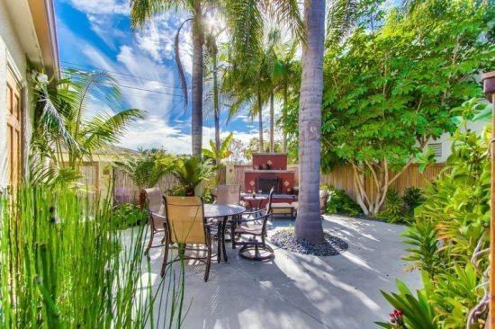 The back cottage patio with fireplace, and dining  - Krystin's Beach Cottage close to Restaurants and Shops! - Pacific Beach - rentals