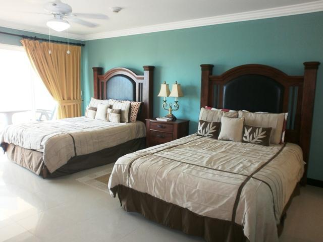 Spacious master bedroom with two queen-size beds! - Glamour View Two-Bedroom condo - E422-2 - Eagle Beach - rentals