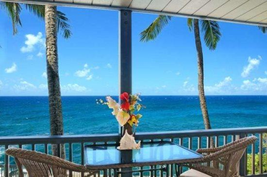 lanai - Free Economy Car* for Poipu Palms 204 - Second story 2 bedroom/2 bath oceanfront condo. - Poipu - rentals