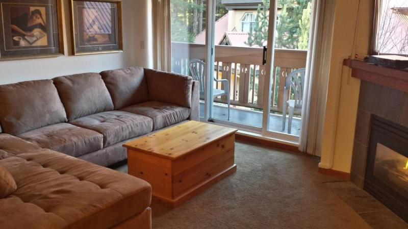 Living area, and entrance to private balcony - Luxury condo close to everything but very quiet - Whistler - rentals