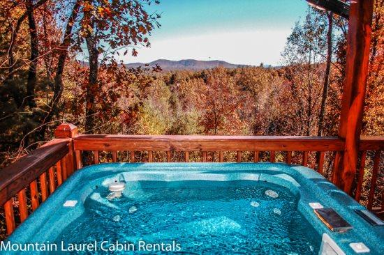 WHITETAIL LODGE- 2BR/3BA, UPSCALE RUSTIC FURNISHINGS, SLEEPS 8, QUIET & SECLUDED, AWESOME MTN VIEWS, HOT TUB, POOL TABLE, WIFI, FOOSEBALL, SAT TV, WOOD BURNING FIREPLACE, GRILL, DECKS ON 3 LEVELS, ONLY $135/NIGHT! - Image 1 - Blue Ridge - rentals