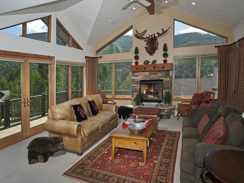 Living Room - A vacation home rental in Vail featuring specially nice scenic mountain views, wrap-around decks and high-end finishes. - Vail - rentals