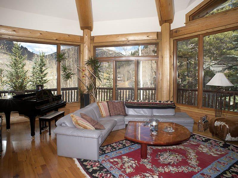 Living Room - From this beautiful vacation home, you`ll especially enjoy the wrap-around deck and panoramic views. - Vail - rentals
