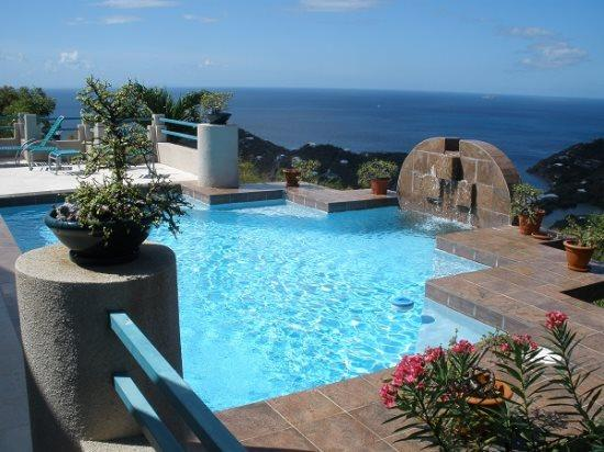 Large pool with waterfall is the focal point of the expansive, private patio - Sunset Vista - U.S. Virgin Islands - rentals