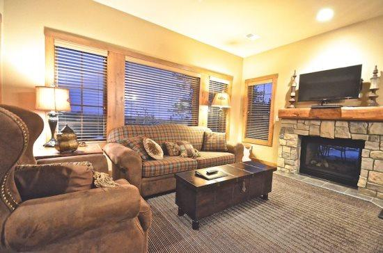 Spacious Living Room with Queen Sofa Sleeper, Flat Screen TV, DVD Player, and Indoor/Outdoor Fireplace. - 2BR Creekside Condo at Boyne Mountain - Truly Slope-side in Boyne`s Newest and Most Luxurious Condo Community - Boyne Falls - rentals