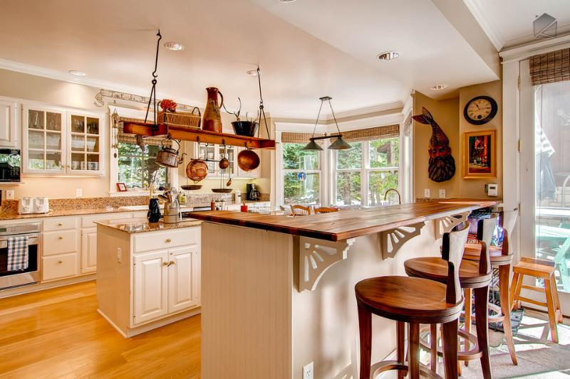 The brand new kitchen with island is big enough to tackle any culinary challenge. - The world does revolve around you - Private hot tub, game room - Sunshine Home - Telluride - rentals
