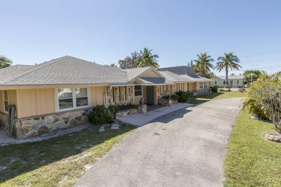 Exterior on Aberdeen Ave. looking toward the beach - Exceptional Executive 6 Bedroom rental home across from Fort Myers Beach with new granite kitchens and decor -  Sun Palace - Fort Myers Beach - rentals