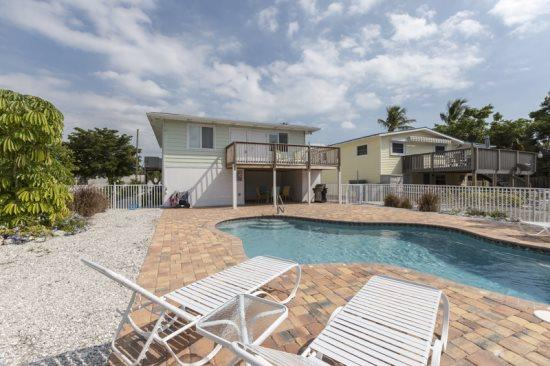 Beach Nuts exterior view from pool area - Beach Nuts Canal Home with New Pool by the Pier -  Beach Nuts - Fort Myers Beach - rentals