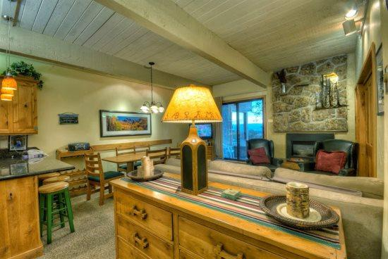 Spacious and Open Living Area, Kitchen and Dining Area With Gas Fireplace, Flat Screen TV and Sleeper Sofa - Storm Meadows A113 - Steamboat Springs - rentals