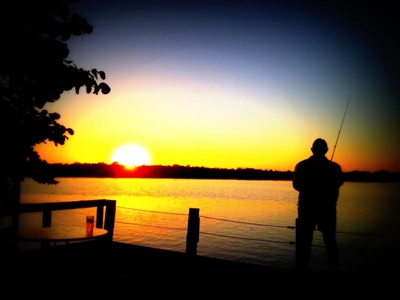 Guest fishing off the dock of Matlacha-Cottages - Sunset at Matlacha Cottages-Pink Water Cottage - Matlacha - rentals