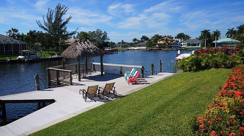 Villa Blue Water - Cape Coral 4b/3ba luxury home w/electric heated pool/spa, gulf access canal, HSW Internet, Boat Dock w/Rental Boat + Tiki Hut - Image 1 - Cape Coral - rentals