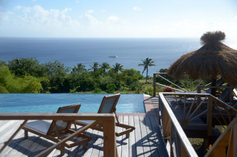 Tet Rouge St. Lucia - relaxing by the infinity pool - Têt Rouge Vacation Studios - St Lucia - Soufriere - rentals