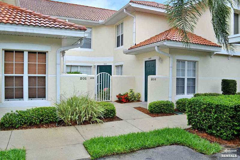 Spacious first floor coach home with beautiful lake views - Image 1 - Naples - rentals