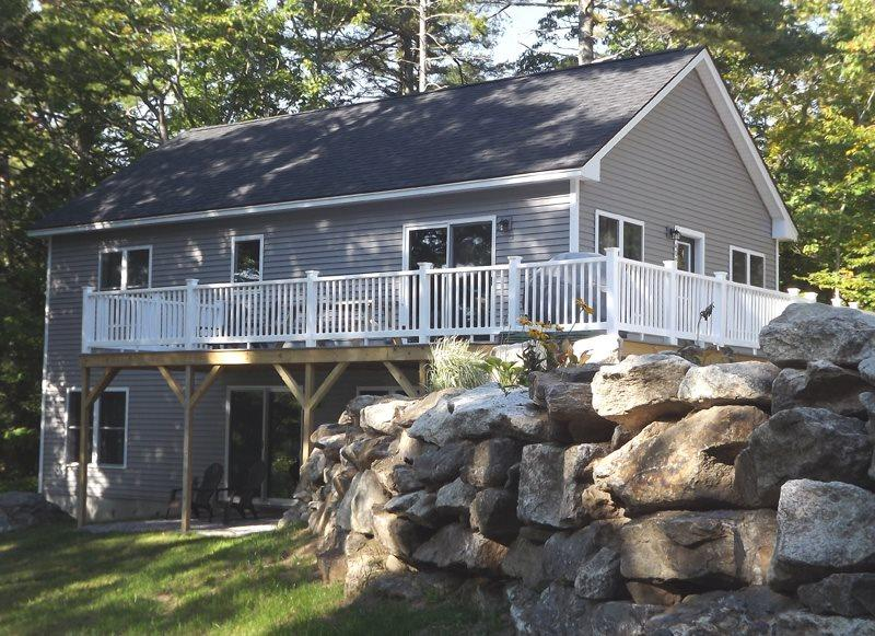 From the large yard looking up to the house and deck - WHITELEY'S WHARF | BARTER'S ISLAND | LEWIS COVE | WATERFRONT WITH DOCK AND FLOAT | OPEN WRAP-AROUND DECK - Boothbay - rentals