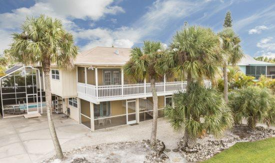 Sun Castle, our large Key West Style Family Vacation home with Private Pool and Hot Tub, All new decor, wood floors and Granite Kitchen -  Sun Castle - Image 1 - Fort Myers Beach - rentals