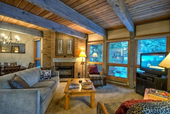 Open Living and Dining Area with Sleeper Sofa, Gas Fireplace, Flat Screen TV - Lodge A109 - Steamboat Springs - rentals