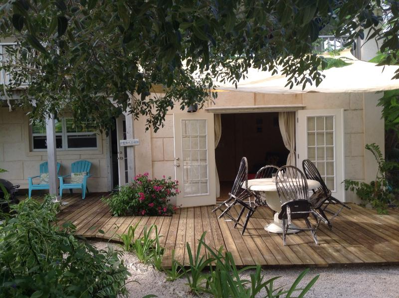 Path approaching the apartment, deck and eating area and BBQ outside - Olde Beach House 2 double ensuites close to beach - Providenciales - rentals