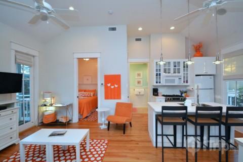 Open Floor Plan with Kitchen and Living Area - Cadiz Cottage - Panama City Beach - rentals