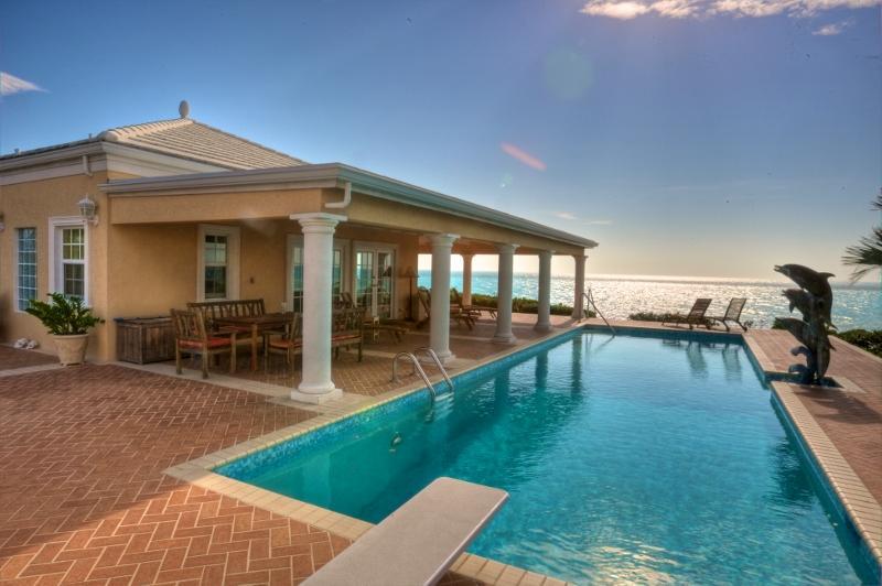Three Dolphins Sandy Beachfront Tennis Villa - Image 1 - Long Bay Beach - rentals