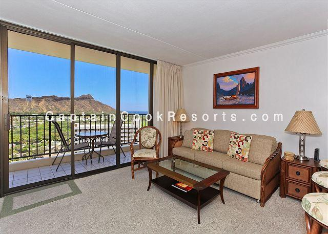 Living area with Diamond Head view - Ocean and Diamond Head views from upgraded one-bedroom vacation rental! - Waikiki - rentals