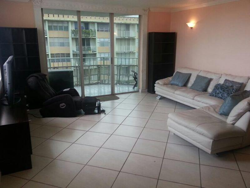 Living Room with White Leather Couch and Large Screen TV - 2 Bedroom Beautiful, POOL & Close to the Ocean - North Miami Beach - rentals