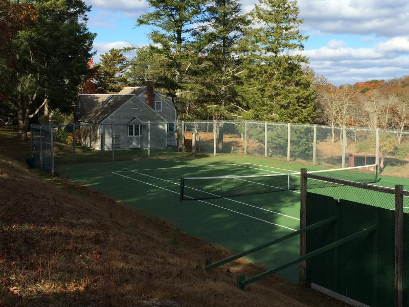 a view of the tennis court and the house from the south - lovely house on meadow's edge - Truro - rentals