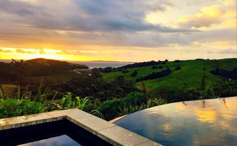 Sunrise over pool New year's Day 2015 by guest - Te Muri Ridge Luxury Accommodation - Auckland - rentals
