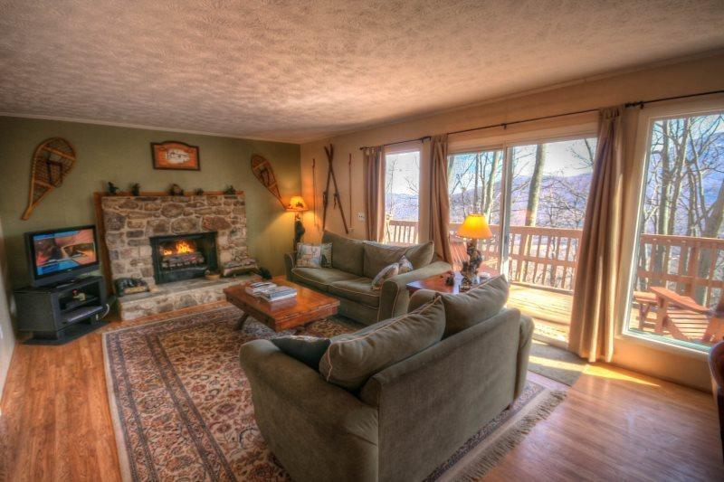 Living Room With Stone Fireplace, Wood Floors and Seasonal Views - Happy Bear Chalet - Boone - rentals