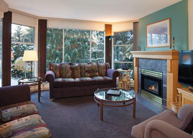 Cozy Living Area with Gas Fireplace and Smart TV - Woodrun Lodge 217 | Ski-in/Ski-out Condo, Common Hot Tub and Pool - Whistler - rentals