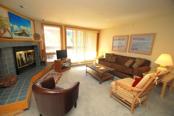 Southwestern themed living room with wood fireplace - Liftside Condominiums 202 - Stainless steel appliances, amazing ski area views, walk to slopes! - Keystone - rentals