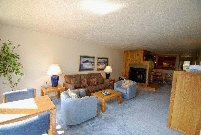 Cozy living room with a wood fireplace - Pines Condominiums 2068 - Amazing mountain views, spacious accommodations! - Keystone - rentals