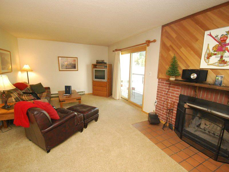 Living room with wood fireplace and queen sofa sleeper - Snowdance Condominium A303 - Walk to slopes, updated bathroom, Mountain House! - Keystone - rentals