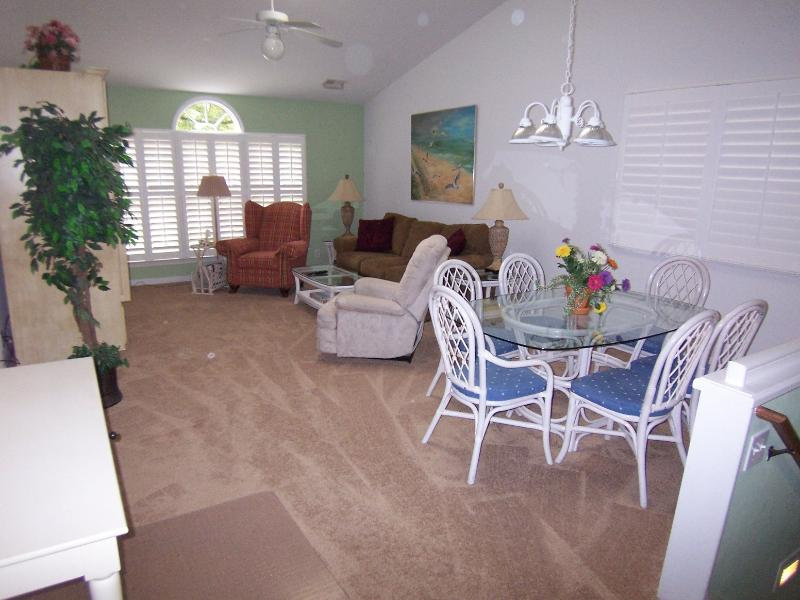 "Spacious living/dining area--2 easy chairs, sofa, 37"" TV/DVD, on golf course, screened porch. - 1 BR BA (23DV), 2nd Floor, King, 1 Mile to Beach - Sunset Beach - rentals"