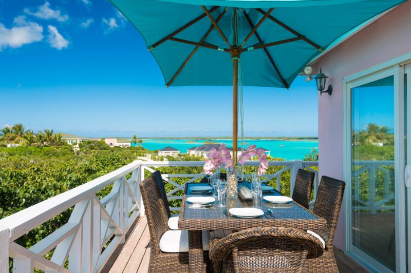 With a wrap around terrace, views are outstanding no matter where you sit.  Alfresco dining for 6. - Angelfish Reef, your romantic hideaway! - Providenciales - rentals