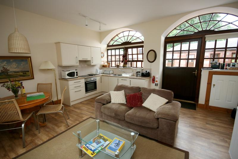 Open plan living area with window and door  inot court yard - Rowan at Finnich Cottages - Scotland - rentals