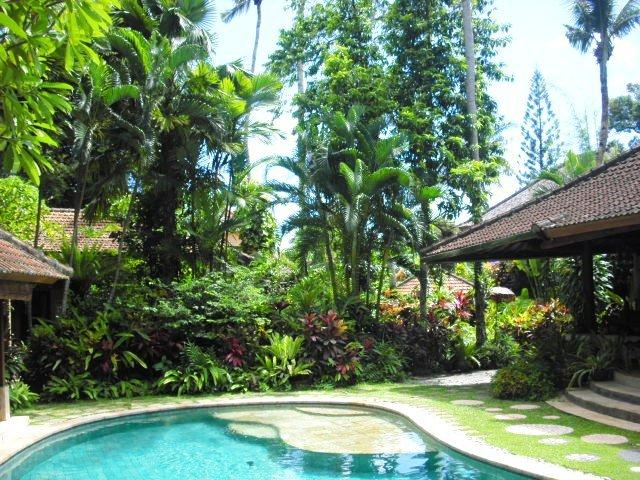 A view from the back of the pool towards the front of the property. - Villa Sanggah Old Style Bali Garden Bungalows - Seminyak - rentals