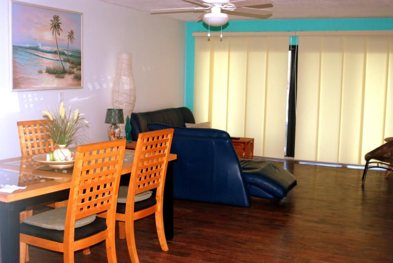 Living Room (58 Inch 4K Wall Mount)  Access your Netflix, Amazon, Etc - Sandcastles Direct Oceanside Condo - Cocoa Beach - rentals