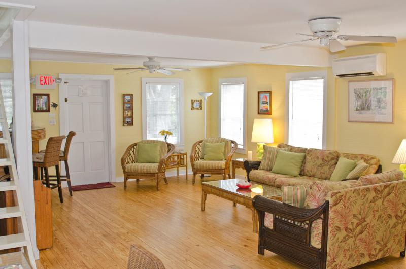 The spacious livingroom was recently remodeled with flatscreen tv, tropical furnishings and artwork. - Sailor House - Key West - rentals