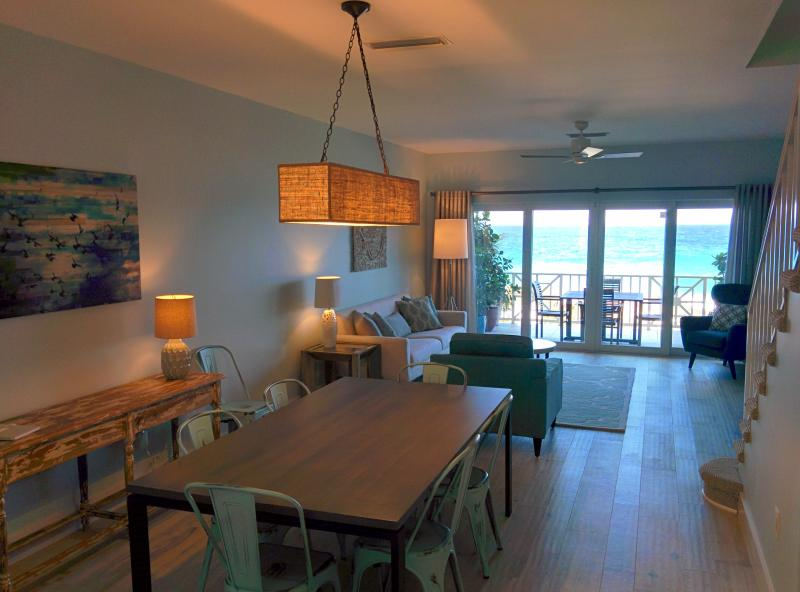 Sweeping ocean views from a newly renovated, tastefully furnished living and dining space - Cayman Sunset, Coconut Bay Oceanfront 3BR near SMB - West Bay - rentals