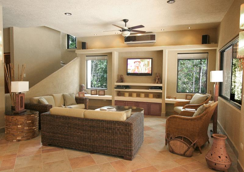 Sink into the comfortable wicker couches and enjoy HBO/Max on the 42 inch TV - 25% off - Casa La Via - Luxury Villa - Akumal - rentals