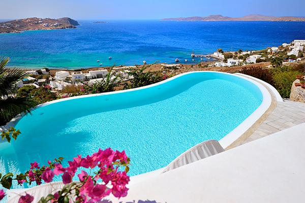 On a hill above Agios Ioannis Beach, this retreat features exceptional panoramic views. LIV APO - Image 1 - Mykonos - rentals