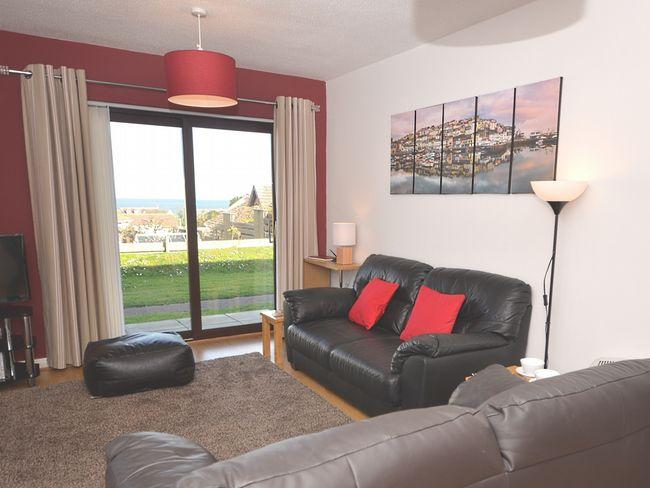 Lounge/ dining area with patio doors and views towards the sea - CLEVI - Brixham - rentals
