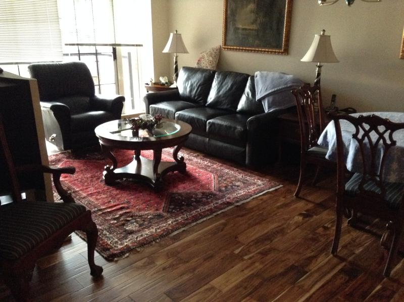 Living room with sleeper sofa and new wood floors - Luxury condo steps to Inner Harbor & Heart of City - Victoria - rentals