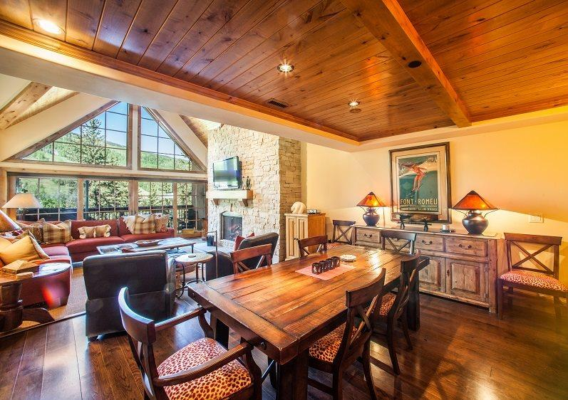 Open living area with stone fireplace and flat screen TV - A vacation condo in Vail Village with beautiful views of Vail Mountain on the banks of Gore Creek, and a private roof-top hot tub. - Vail - rentals