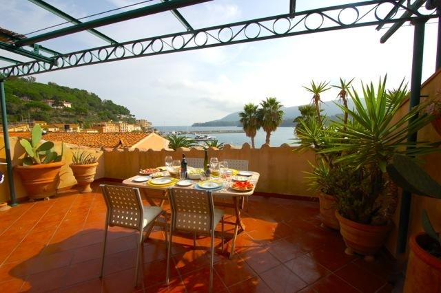 You'll linger longer over lunch with this captivating view. - Baia Blu - Porto Azzurro - rentals